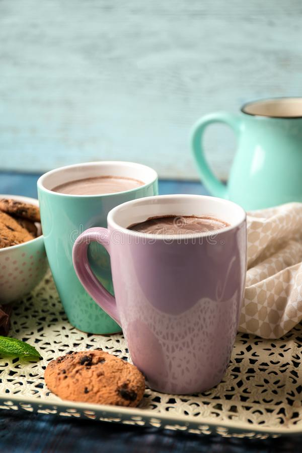 Mugs with hot chocolate on tray stock images