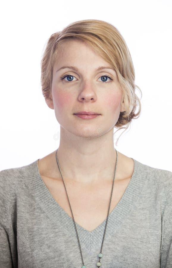 Mugshort d'une belle femme sans l'expression du visage photographie stock libre de droits