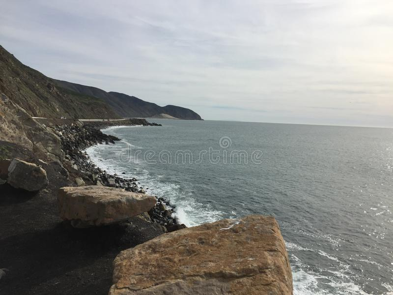 Point Magu California - pristine coastline with ocean and sky. Mugu Rock is a distinctive feature of the coastal headland promontory that has been featured in royalty free stock image