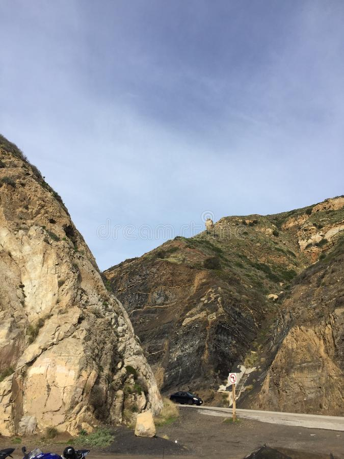 Point Magu California - where the road goes through the rocks. Mugu Rock is a distinctive feature of the coastal headland promontory that has been featured in royalty free stock photos