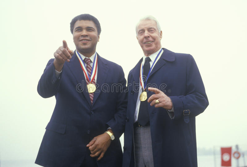 Muhammad Ali and Joe DiMaggio. Wearing gold medals, Ellis Island, NY royalty free stock photos
