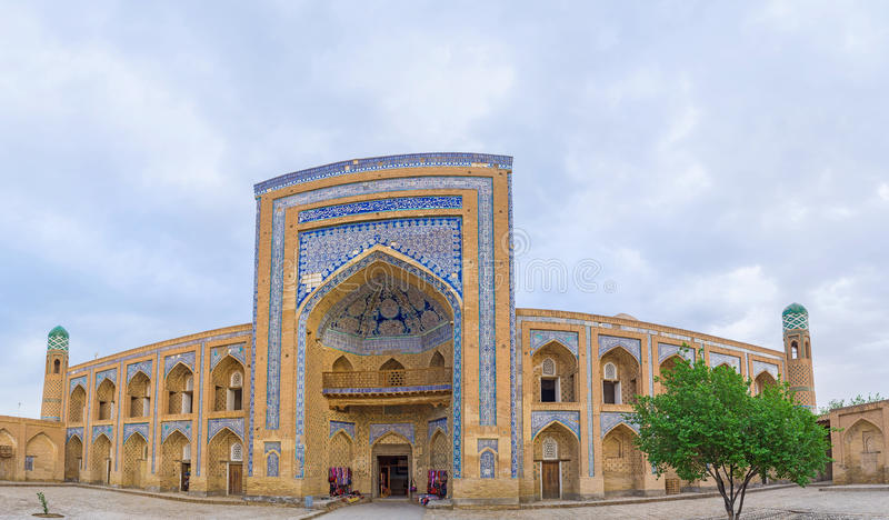 The Muhammad Rahim-khan Madrasah. Panorama of the medieval Muhammad Rahim-khan Madrasah, that nowadays serves as the tourist market with the wide range of the stock photography