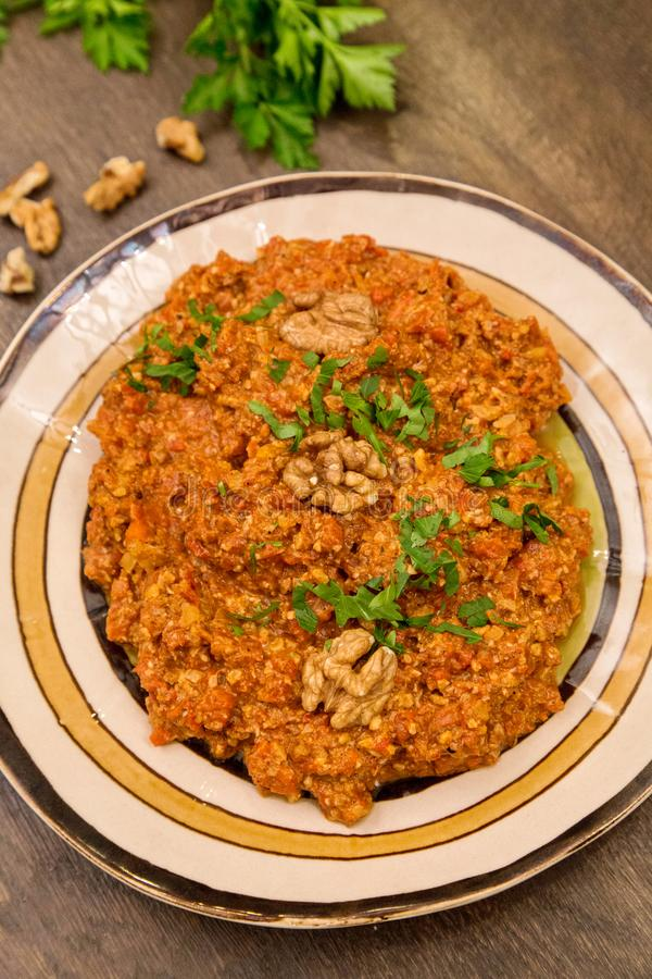 Muhammara traditional Arabic mezze. Lebanese food. Muhammara traditional Arabic mezze. Traditional spicy lebanese dish made of sweet peppers with walnuts, cumin royalty free stock photos