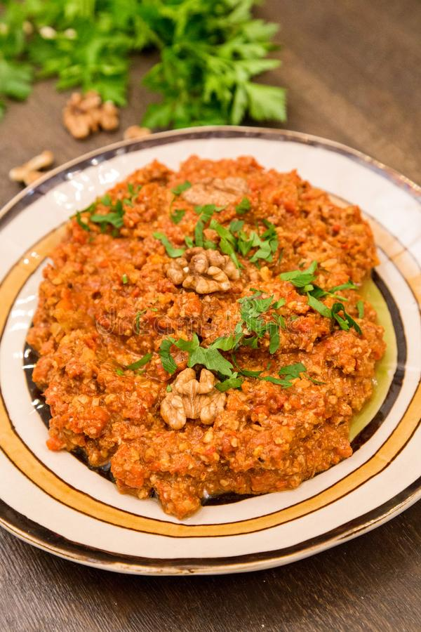 Muhammara traditional Arabic mezze. Lebanese food. Muhammara traditional Arabic mezze. Traditional spicy lebanese dish made of sweet peppers with walnuts, cumin stock image
