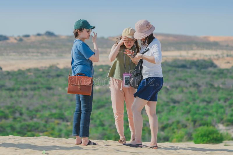 MUI NE, VIETNAM - APRIL 25 : Unidentified tourists relax and take photos on April 25,2019 at white sand dune desert in Mui Ne, royalty free stock photos