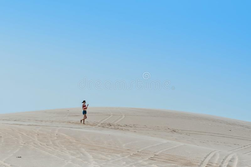 MUI NE, VIETNAM - APRIL 25 : Unidentified tourists relax and take photos on April 25,2019 at white sand dune desert in Mui Ne, stock photo