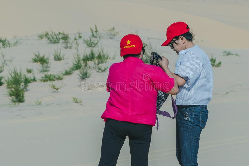 MUI NE, VIETNAM - APRIL 25 : Unidentified tourists relax and take photos on April 25,2019 at white sand dune desert in Mui Ne, royalty free stock images