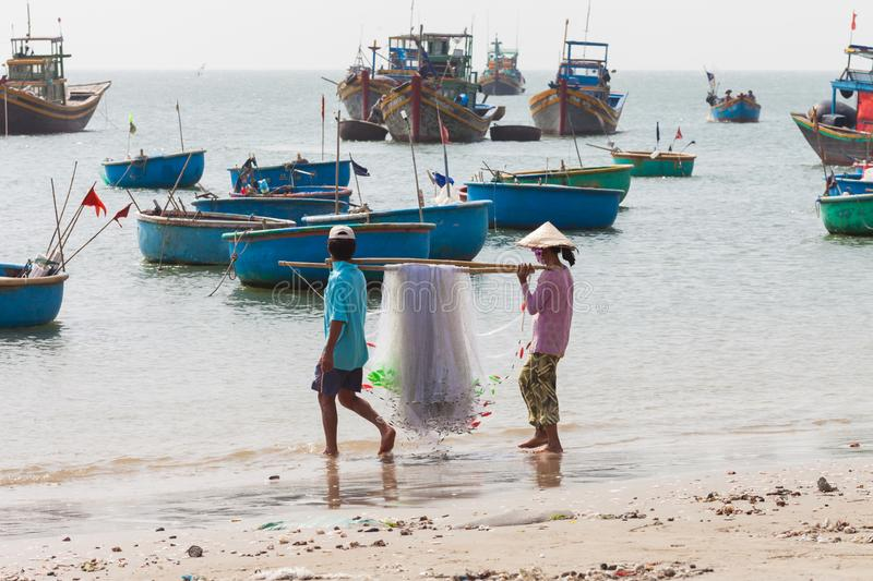 Vietnamese fishermen couple with nets stock images
