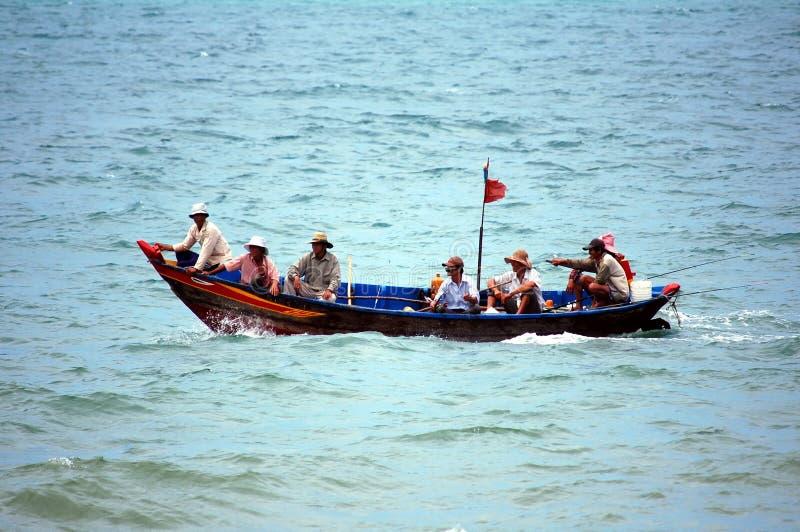 Vietnamese fishermen in boat royalty free stock photos