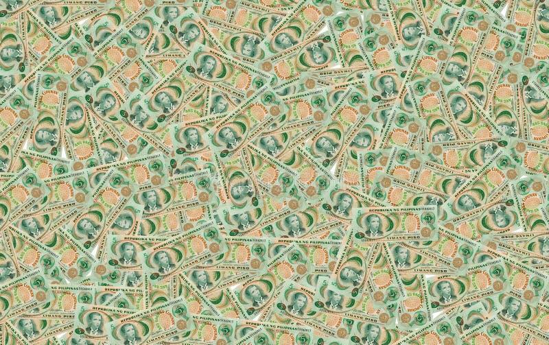 Muitas cédulas cinco pesos Filipinas no fundo imagens de stock royalty free