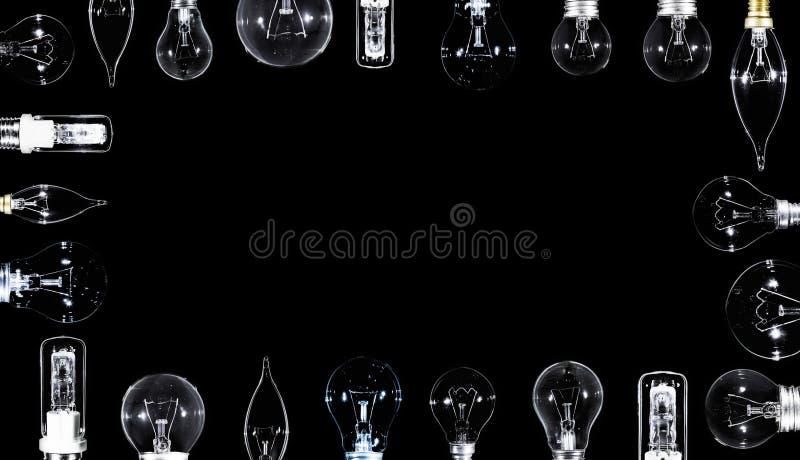 Muitas lâmpadas de Edison sobre o preto, copyspaced imagem de stock royalty free