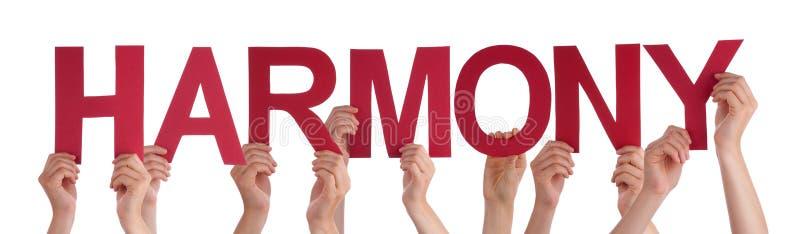 Muitas mãos dos povos guardam a harmonia reta vermelha da palavra foto de stock royalty free