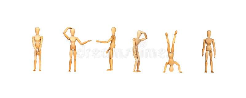 Muito manequim de madeira que faz gestos dos differents foto de stock royalty free