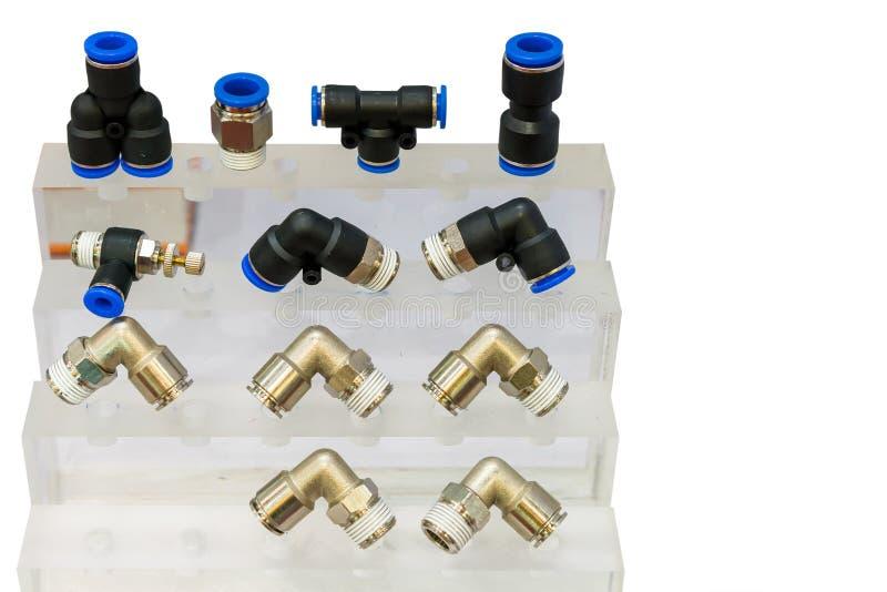 Muito tipo do metal e do conector rápido plástico do equipamento do acoplamento ou dos encaixes para o ar ou do líquido na pratel foto de stock royalty free