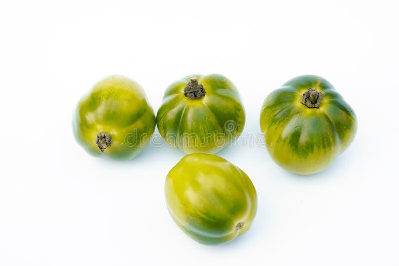 Muito tomate no fundo branco imagem de stock