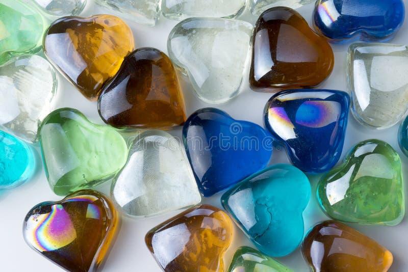 Muitos corações de vidro de cores diferentes imagem de stock royalty free