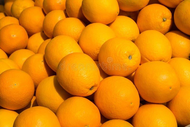 Muitos frutos da laranja - fundo alaranjado do fruto fotos de stock royalty free