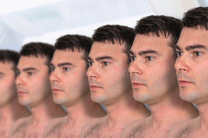 Muitos homens - conceito genético do clone fotos de stock royalty free