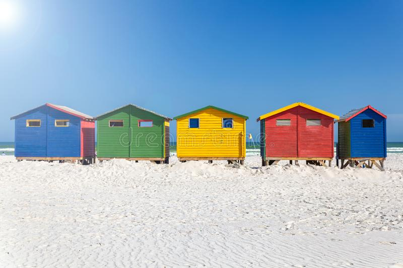 Muizenberg beach with white sand and colorful wooden cabins in Cape Town royalty free stock images