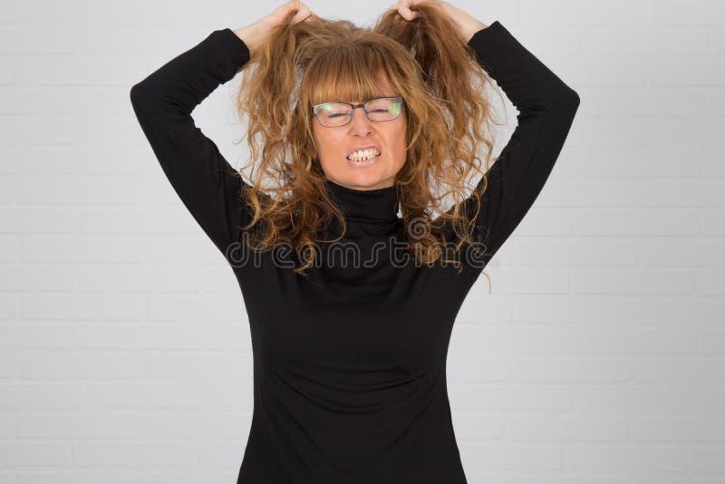 Mujer adulta enojada fotos de archivo
