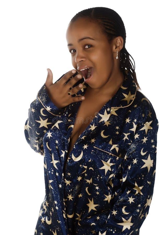 Mujer africana soñolienta imagen de archivo