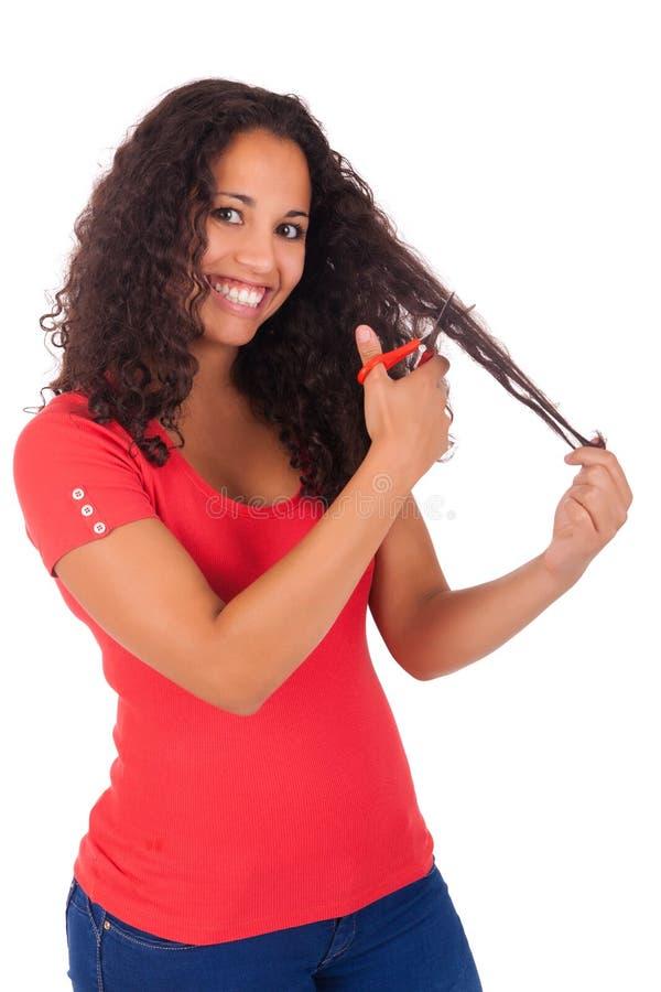 Mujer afroamericana joven con el pelo largo imagenes de archivo