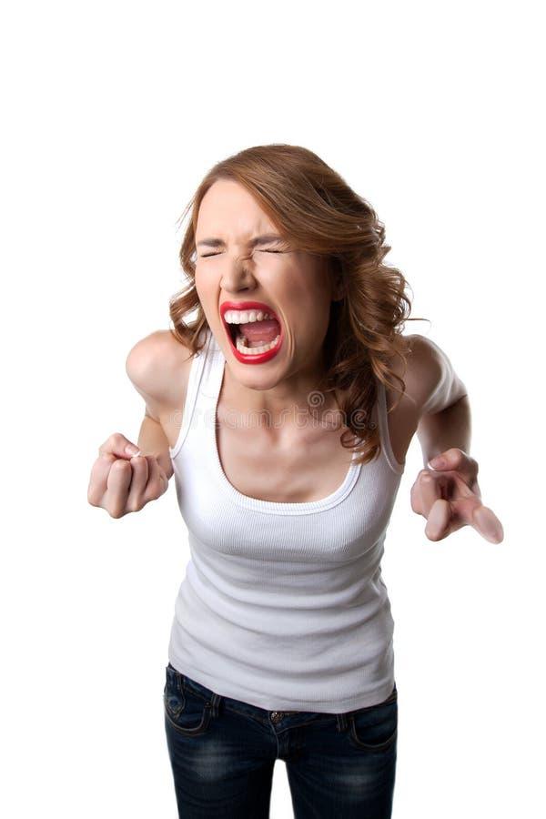 Mujer agresiva en el grito de la tapa del tanque aislado fotografía de archivo libre de regalías
