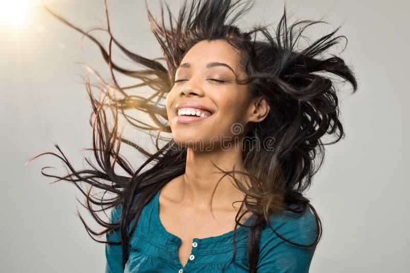 Mujer alegre con el peinado fotografía de archivo libre de regalías