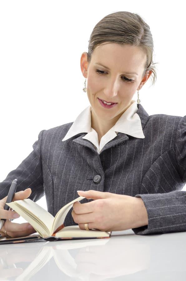 Mujer Alegre En El Escritorio Blanco Imagenes de archivo