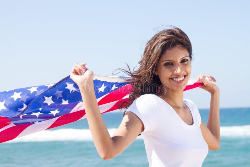 Mujer americana feliz imagen de archivo