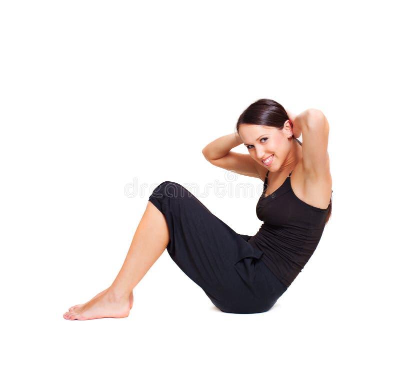 Mujer animada que hace ejercicios del deporte imagen de archivo