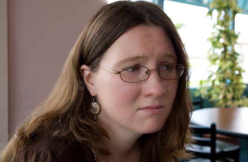 Mujer apenada foto de archivo libre de regalías