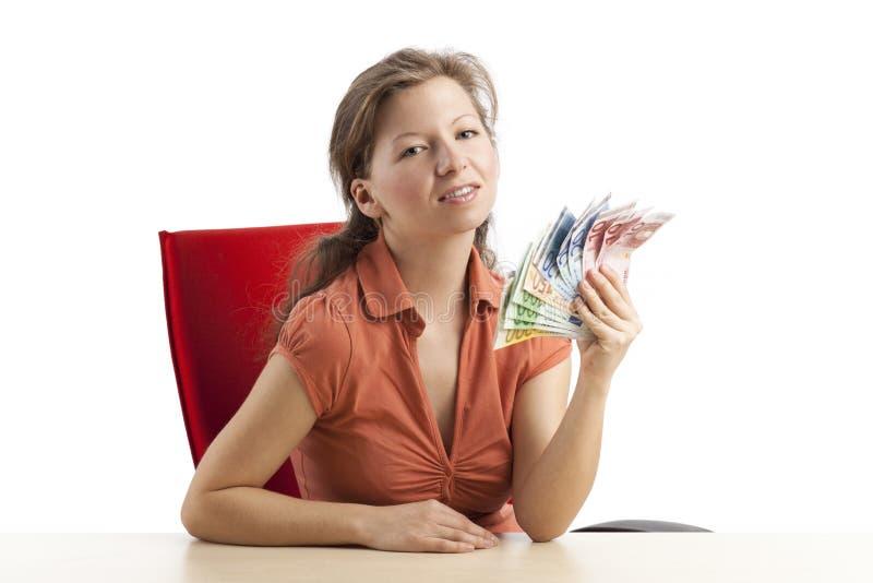 Mujer arrogante con un ventilador del dinero imágenes de archivo libres de regalías