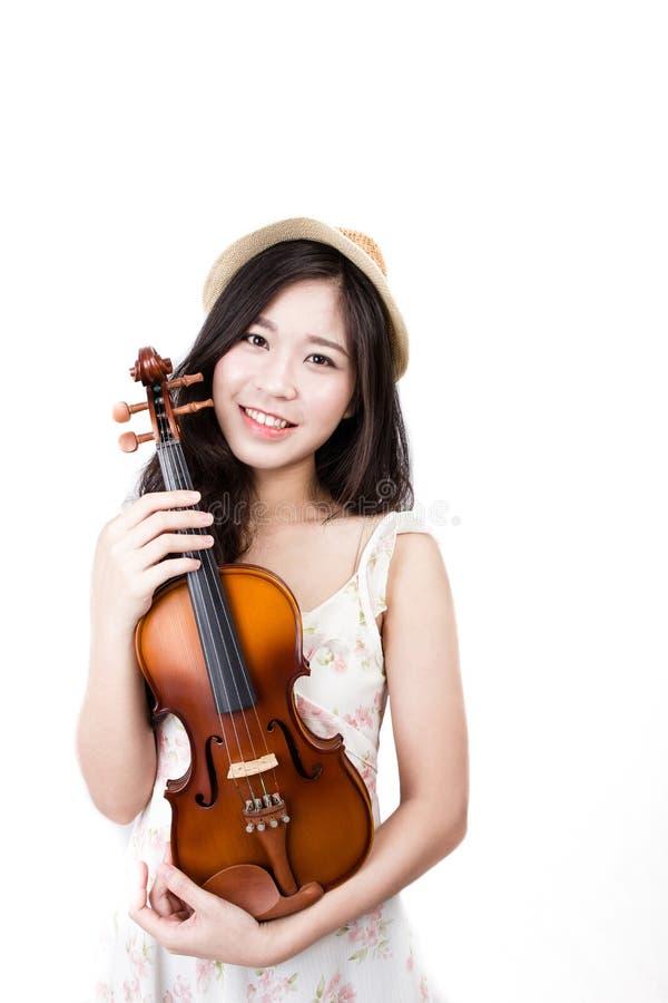 Mujer asiática con el violín foto de archivo
