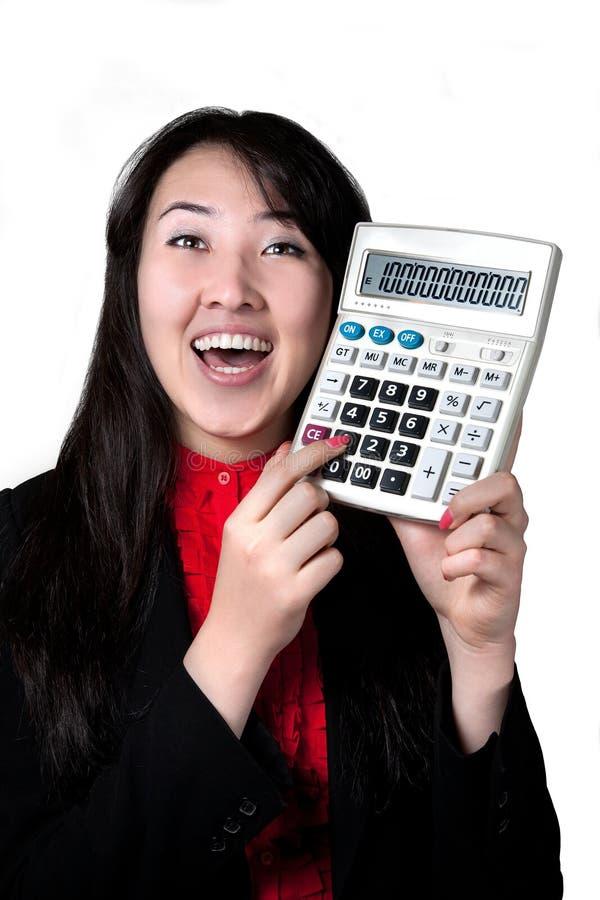 Mujer asiática con la calculadora foto de archivo
