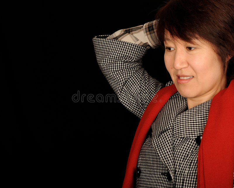 Mujer asiática dada una sacudida eléctrica imagen de archivo libre de regalías