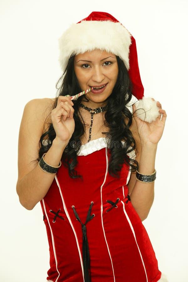 Mujer asiática de la Navidad con el palillo del bastón de caramelo fotos de archivo