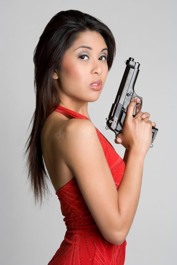 Mujer asiática del arma imágenes de archivo libres de regalías