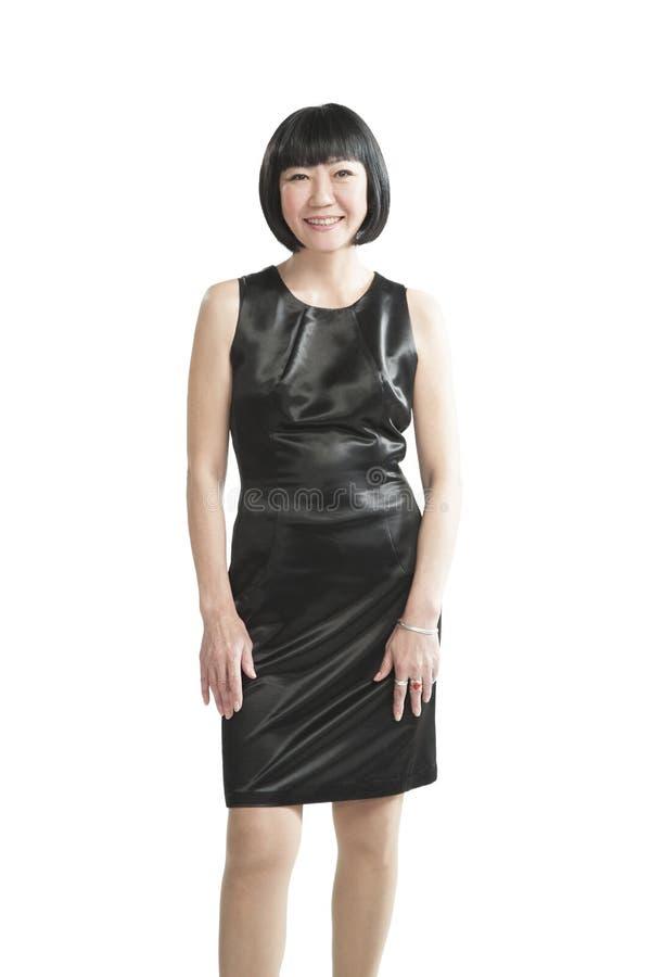 Mujer asiática en vestido negro imagen de archivo libre de regalías