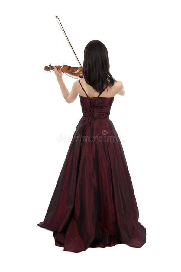 Mujer asiática joven que toca el violín foto de archivo libre de regalías
