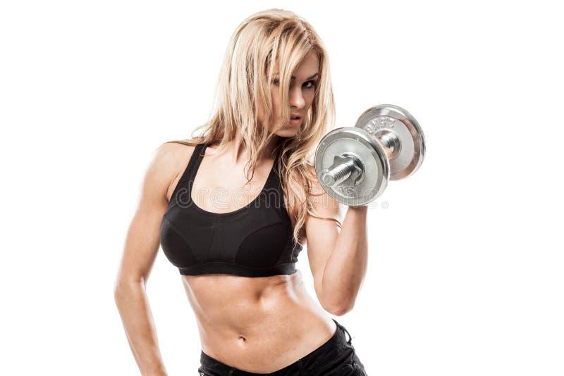Mujer atlética con pesas de gimnasia fotos de archivo