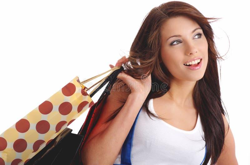 Mujer atractiva con el bolso de compras foto de archivo libre de regalías