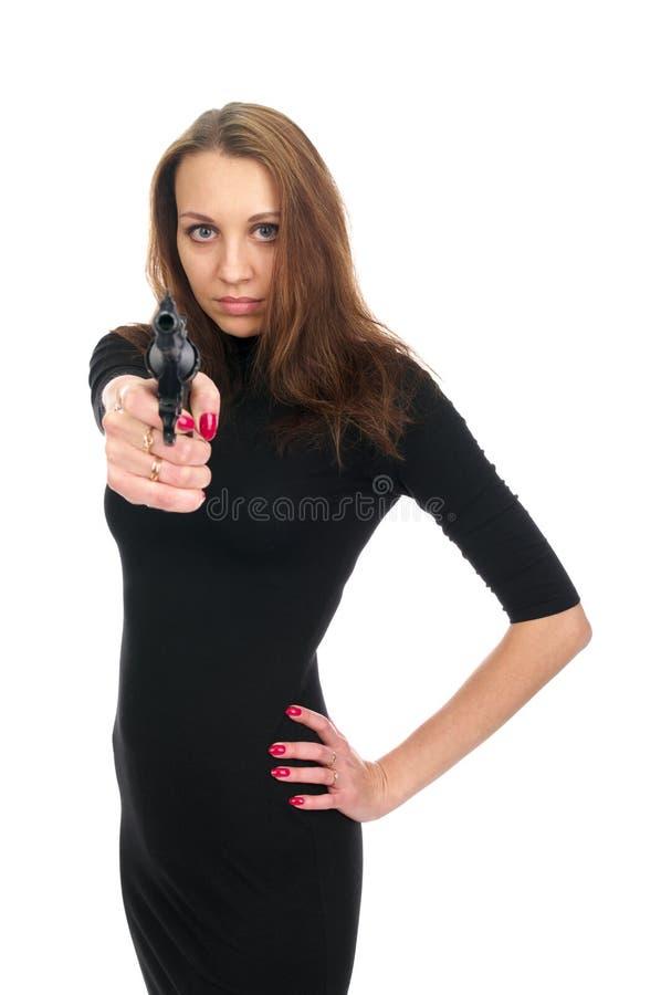 Mujer atractiva con un arma imagen de archivo