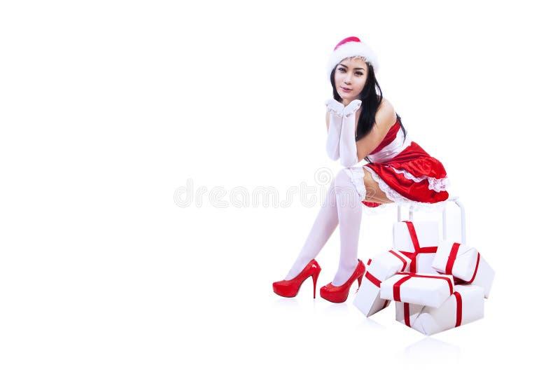 Mujer atractiva de Claus aislada sobre blanco foto de archivo