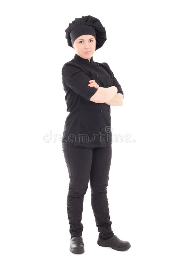 Mujer atractiva del cocinero en el uniforme del negro aislado en blanco imágenes de archivo libres de regalías
