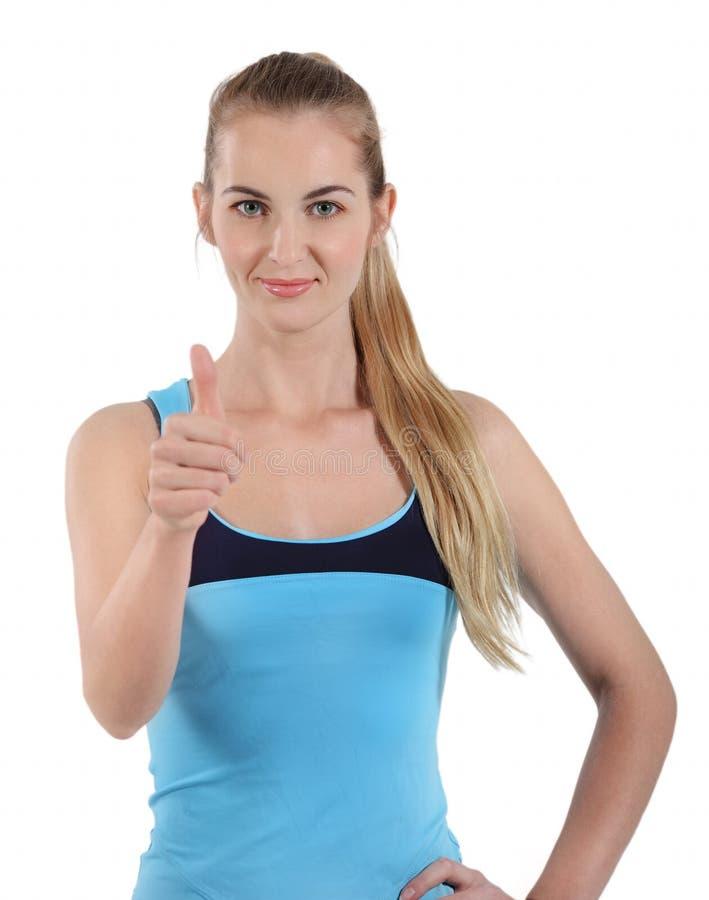 Mujer atractiva en el fondo blanco con el pulgar para arriba imágenes de archivo libres de regalías
