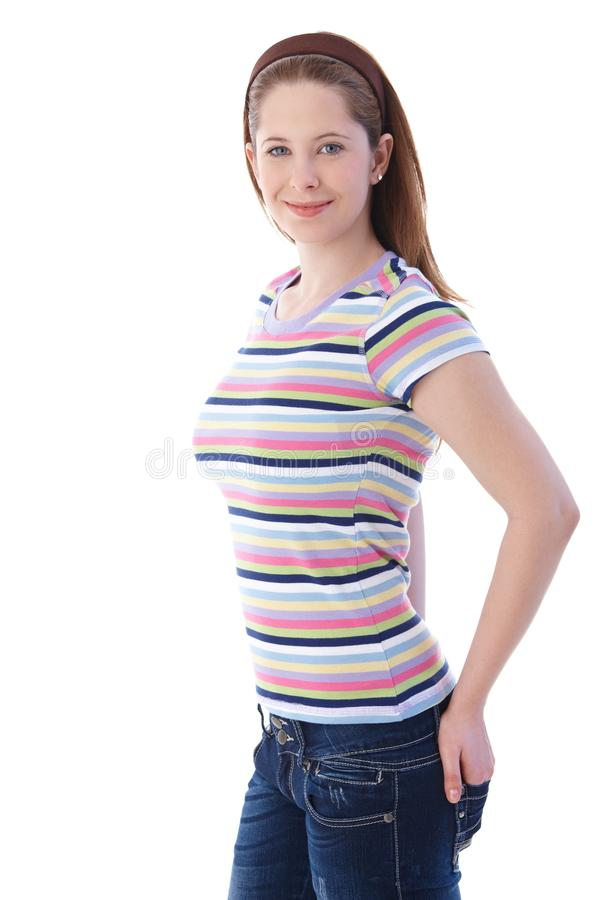 Mujer atractiva en la camiseta pantalones vaqueros fotografía de archivo libre de regalías
