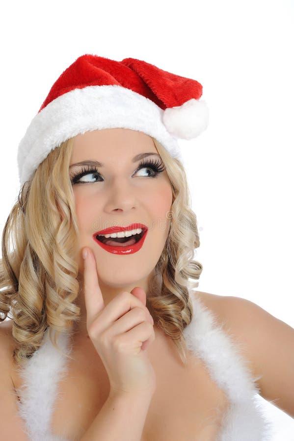Mujer atractiva hermosa de Papá Noel en sombrero del rojo del partido foto de archivo