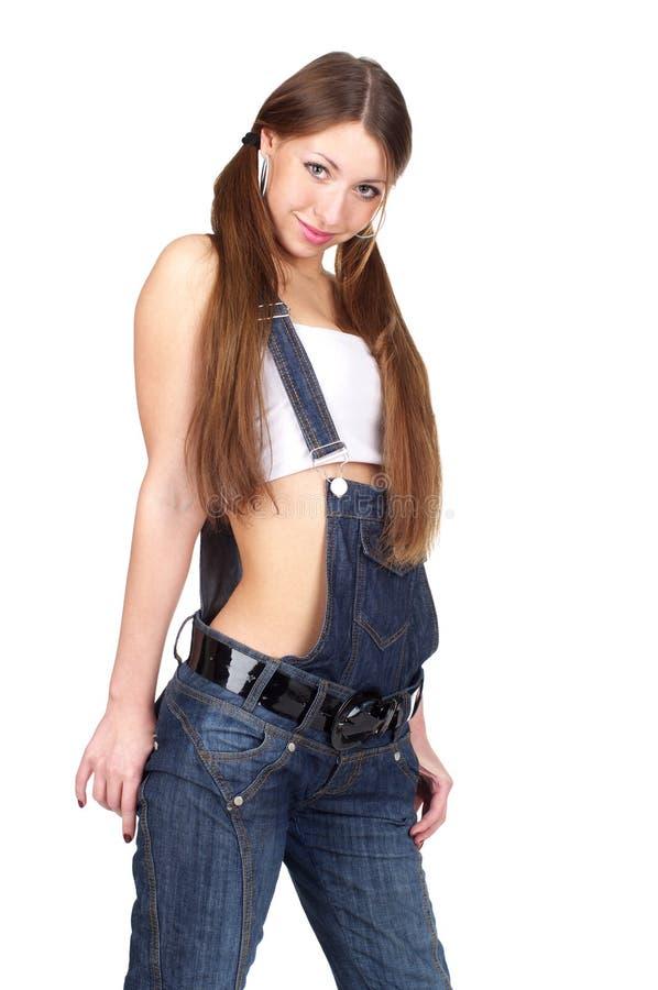 Mujer atractiva hermosa en pantalones vaqueros foto de archivo