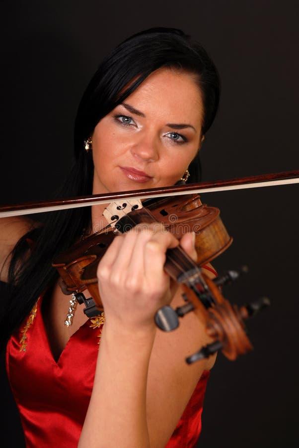 Mujer atractiva hermosa joven con el violín foto de archivo libre de regalías